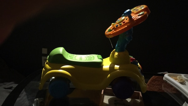 yellow, blue, and green plastic toy