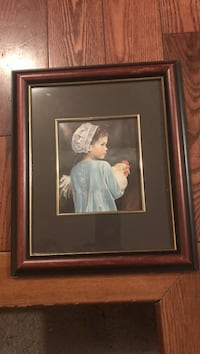 Girl holding chicken wall art with brown frame London, N5V 1N6