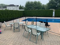 2 tempered glass outdoor dining tables and 8 chairs total-no umbrella