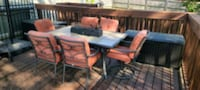Patio table set with fire pit