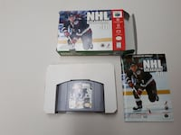 black Nintendo 3DS with game cartridge