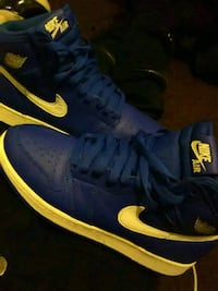 pair of blue-and-yellow Nike sneakers