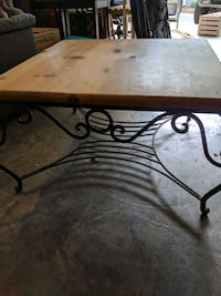 Pine and wrought iron coffee table.  Tega Cay, 29708