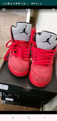 Size 7 pair of red Air Jordan basketball shoes