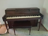 brown wooden spinet piano