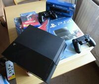 black Sony PS3 slim console with controller and game cases Woodlawn, 21207