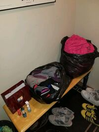 Clothes size small med nail polish and a pick blanket