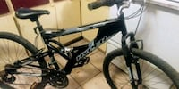 black and gray full-suspension mountain bike