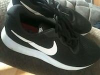 pair of black-and-white Nike running shoes Jacksonville, 28546