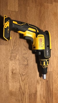 black and yellow DeWalt cordless power drill