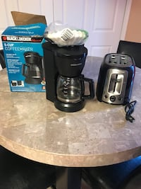 Black and gray coffeemaker and 2-slice bread toaster in great condition  Laurel, 20724