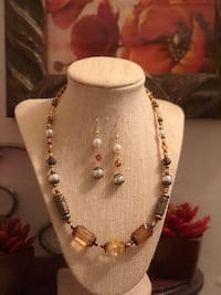 Necklace and hook earrings costume jewelry set.