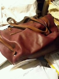 pair of brown leather boots 288 mi