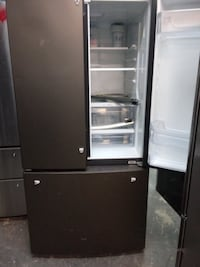 """General Electric New Slate/Stainless 33"""" Inch Wide Fridge 3-Door with Ice Maker. Height is 68"""" Inch and Depth is 27"""" Inch. Also, New GE Slate/Stainless Slide In Gas Stove 30"""" Inch Wide with Self Clean. Both Are New with Minor Scuff/Ding. Still looks Great 218 mi"""