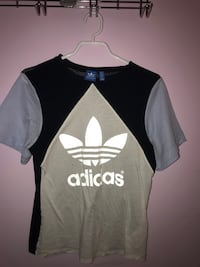 beige, white, and black Adidas crew-neck t-shirt