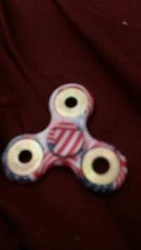 red and blue three-bladed fidget spinner Reisterstown, 21136