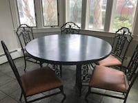 dark green table with two 12 inch leaves and five cast aluminum chairs.  Seats 8. PAWTUCKET