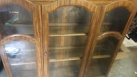 brown wooden framed glass cabinet hutch with bottom half also not in picture  Hagerstown, 21740