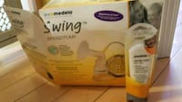 white and yellow Medela electric breast pump box 782 km