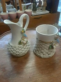 two white ceramic candle holders Montreal, H8S 3P6