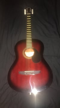red and black acoustic guitar Rockville, 20853