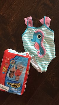 3 t bathing suit with new pack of huggies swimmers Columbus, 31907