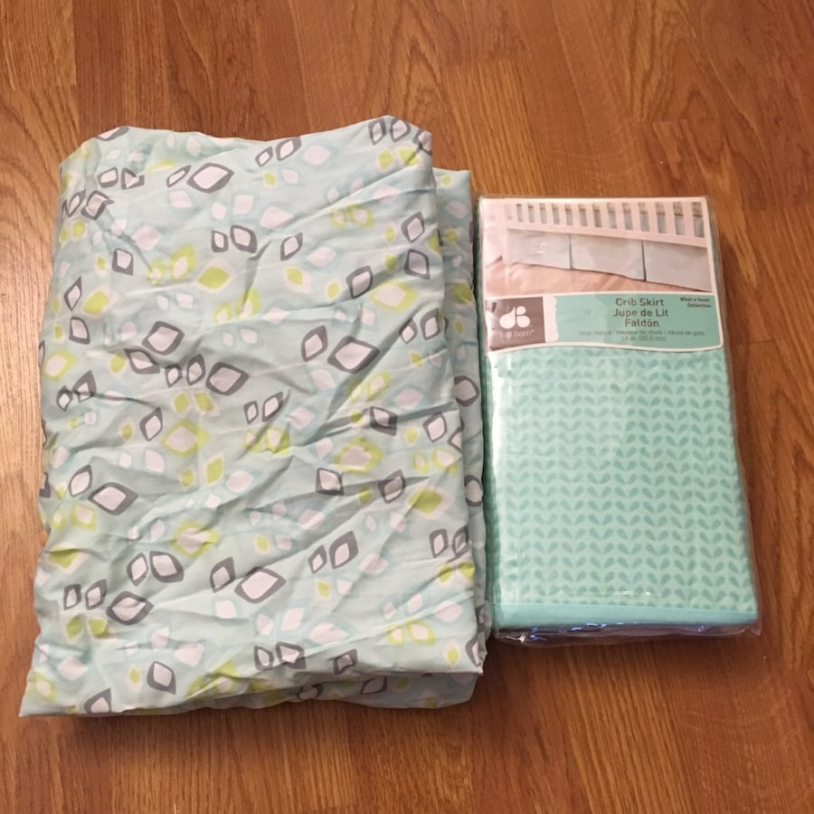 New crib skirt and crib sheet