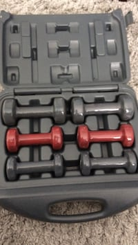 three pairs of black and red dumbbells with case Kelowna, V1Y 3G3
