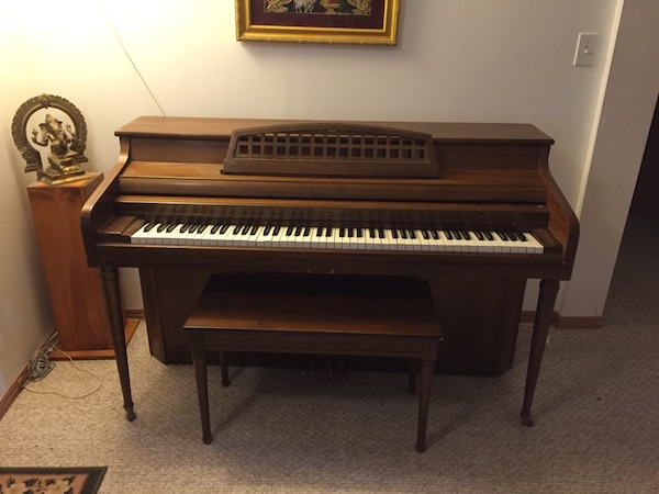 Brown Wooden Upright Piano  Price is $450 and negotiable