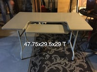 laminate desk w/folding legs*good condition not perfect see closeup
