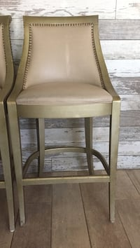 white leather padded gray wooden barstool