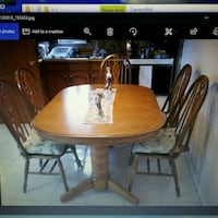 oval brown wooden table with four chairs dining set Mississauga, L5V 1E9