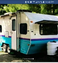 white and blue RV trailer Muskegon, 49441