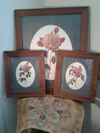 Three pieces hanging flowers wall art.