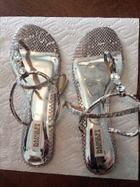 pair of gray-and-silver t-strap Badgley Mischka sandals size 9.5