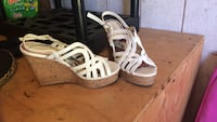 pair of white leather cork wedge sandals