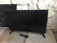 Black flat screen tv with hdmi and USB port and remote  2393 mi