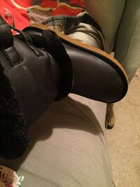 pair of black leather boots 1015 mi