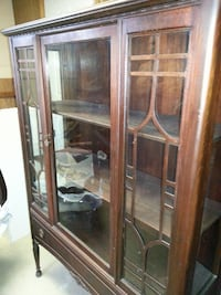Finksburg, MD  brown wooden framed glass display cabinet null