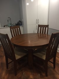 round brown wooden table with four chairs dining set 588 km
