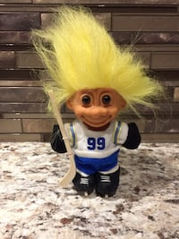 White and blue trolls hockey player toy