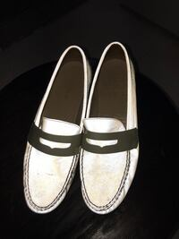 Pair of white leather penny loafers