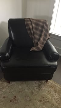 Black leather sofa chair with ottoman North Vancouver
