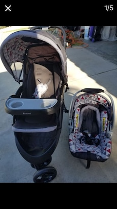 Black and gray jogging stroller and car seat