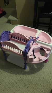 Toddler's pink, white and purple plastic crib toy set