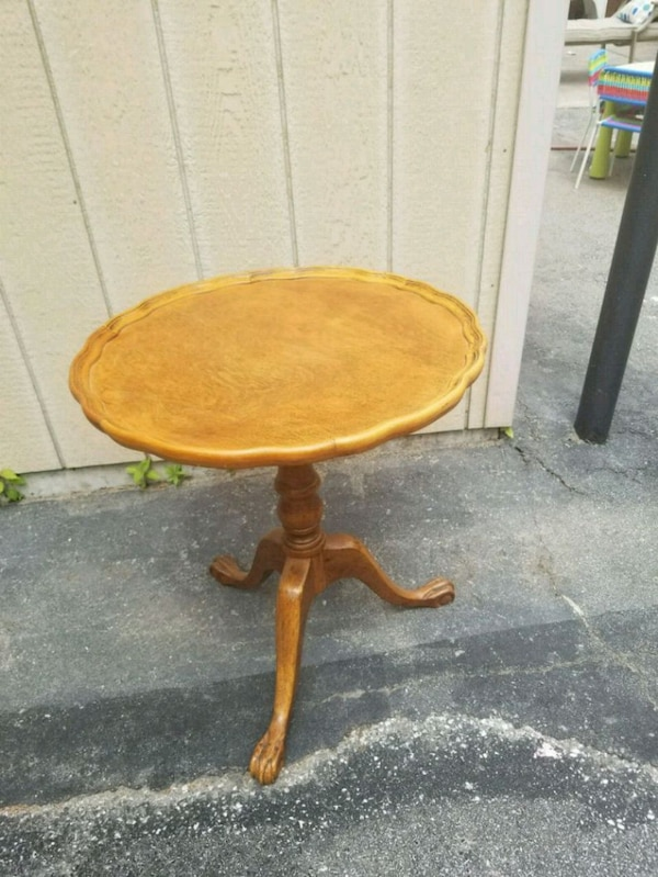 round brown wooden pedestal table