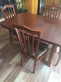 rectangular brown wooden table with six chairs dining set Montreal, H9J 3R2