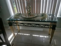 black metal framed glass top coffee table