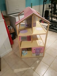 brown and pink 3-storey doll house 586 km