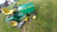 green and yellow John Deere ride on lawn mower Swansea, 02777